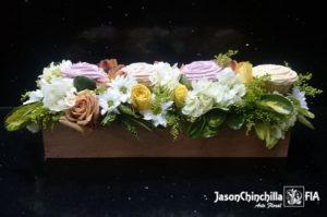 Caja con cupcakes y flores